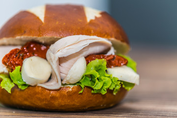 Fresh baguette sandwich on wooden background. Classic BLT sandwiches. Close up.