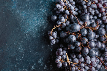 Top view of dark blue grapes on a vintage background.