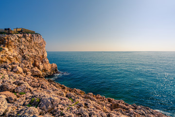 Cliff in Salou Cape situated in Costa Daurada, Spain. OIange and teal style