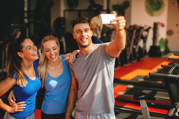 Friends making selfie in the gym