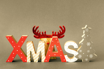 Christmas decoration with xmas text and hidden reindeer