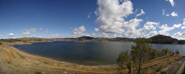 panoramic view of an almost full water resevoir/dam in Rural New South Wales during a drought, very dry season, local water supply used in farming, Australia Wall mural