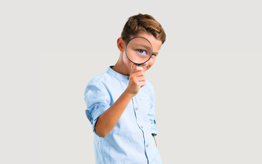 Little kid with magnifying glass