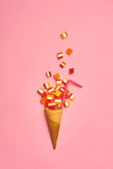 Flat lay : Ice cream cone with colorful party streamers on yellow background with copy space