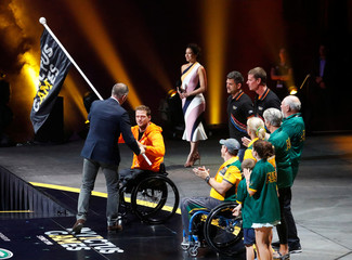 The Invictus Games flag is handed over to the next host city The Hague during the closing ceremony of the Invictus Games at the Qudos Bank Arena in Sydney