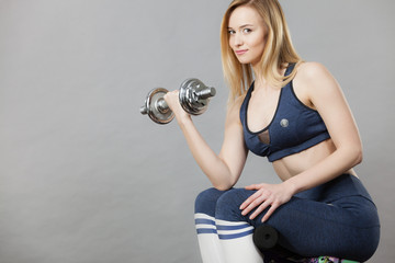 Woman training weight lifting