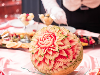 Close up of carved watermelon as rose in the restaurant. Carving on fruits and berries