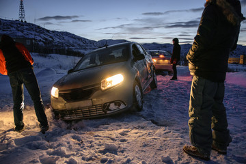 Car at night in snowbank, Teriberka, Murmansk Region, Russia