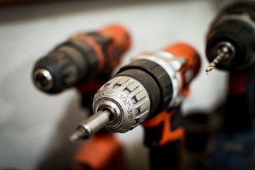 Battery Drill Set orange and black seen close up blurred background