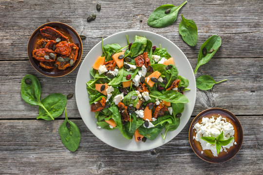 Fresh salad with vegetables, vegetarian food on plate, top view
