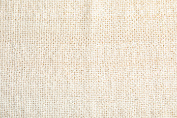 Light natural hemp cloth as background. Fabric texture