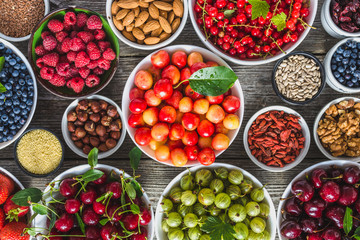 Selection of food, fresh fruits and vegetables, berries, nuts and seeds. Healthy eating concept