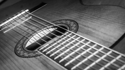 closeup of acoustic wooden guitar. black and white