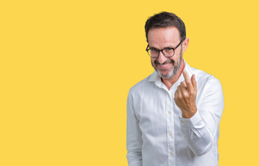 Handsome middle age elegant senior business man wearing glasses over isolated background Beckoning come here gesture with hand inviting happy and smiling