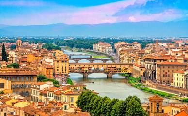 Aluminium Prints Florence Aerial view of medieval stone bridge Ponte Vecchio over Arno river in Florence, Tuscany, Italy. Florence cityscape. Florence architecture and landmark.