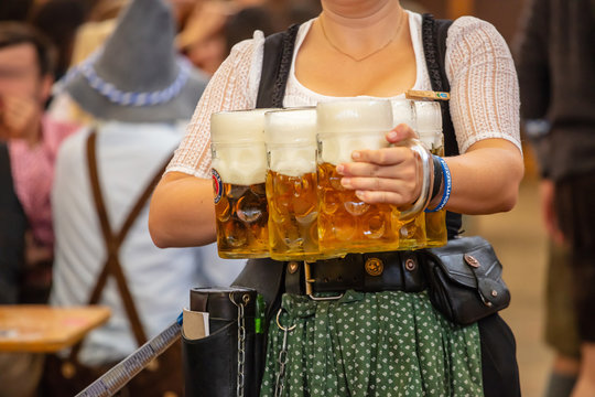 Oktoberfest, Munich, Germany. Waiter with traditional costume holding beers