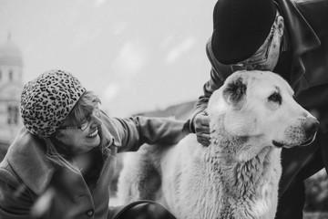 Mature woman and dog -white black photo
