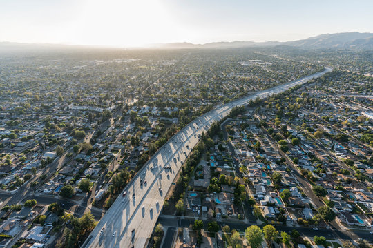 Sunset aerial view of Route 118 freeway crossing the San Fernando Valley in Los Angeles, California.