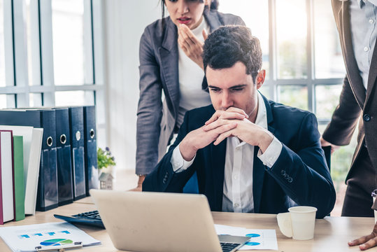 Businessman worry about his job with serious boss discussing while commenting a financial report document at meeting.