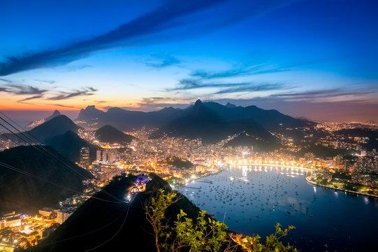 Aerial view of Rio de Janeiro at night with Urca and Corcovado mountain and Guanabara Bay - Rio de Janeiro, Brazil