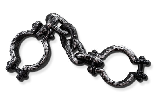 Slavery and bondage concept with strong steel shackles isolated on white background with a clip path cutout