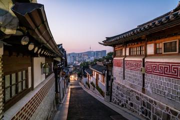 Sunrise scene of Bukchon Hanok Village at Seoul city, South Korea. Bukchon Hanok Village is home to hundreds of traditional houses.