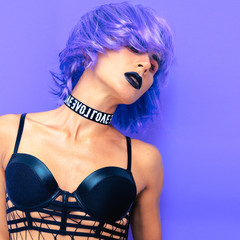 Sensual model with purple hair. Night party outfit. Freak vibes
