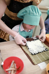Boy making sushi