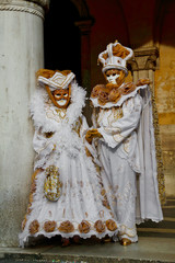 Colorful carnival white-gold mask and costume at the traditional festival in Venice, Italy