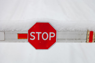 Stop sign on the barrier close-up