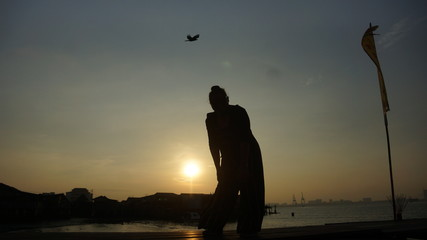 Beautiful silhouette during sunrise at Tan Jetty, George Town, Penang