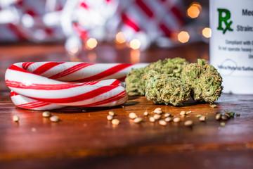 Marijuana buds, hemp seeds, and peppermint candy canes with bokeh lights