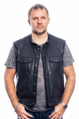 Brutal man in a leather jacket, isolated on white background