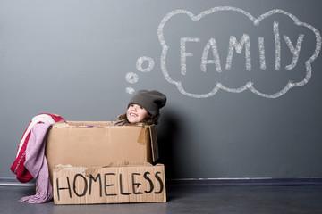 Homeless girl in paper box
