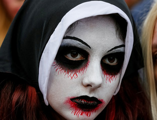 """A participant takes part in a """"Zombie Walk"""" parade in Kiev"""