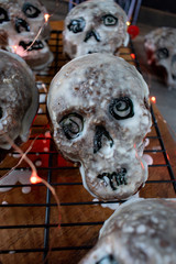Halloween skull cakes dipped in white glaze for party