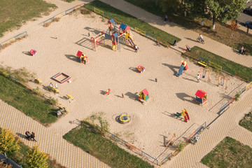 Children playground. Children's and sports grounds in the courtyard of new buildings in Europe. Top view. Aerial view of American playground with slides, swings