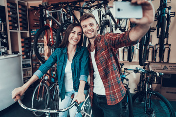 Young Guy and Girl Make Selfie at Bicycle Store