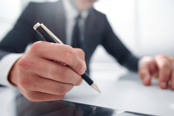 close up.businessman signing contract