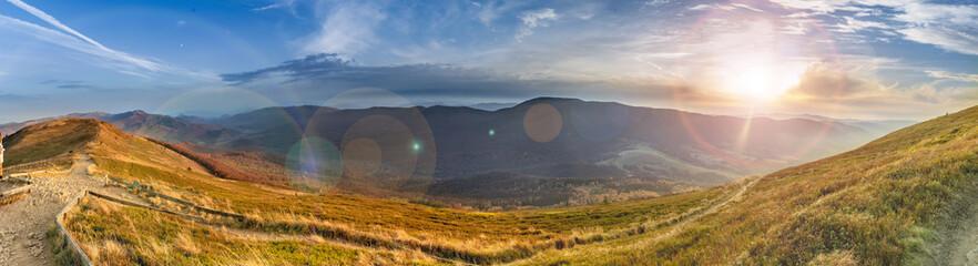 Fototapeten Gebirge Sunset in the autumn in the mountains. Bieszczady National Park - Caryńska meadow - Poland.