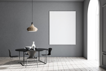 Gray dining room, black table, poster