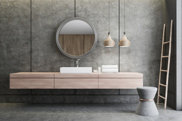 Sink and mirror in concrete bathroom