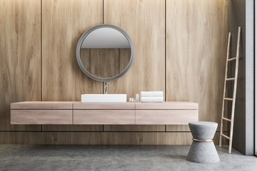 Sink and mirror in wooden bathroom
