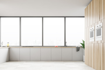 Panoramic kitchen with white counters, oven