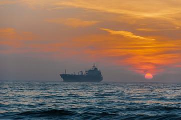 Cargo Ship At Beautiful sunset
