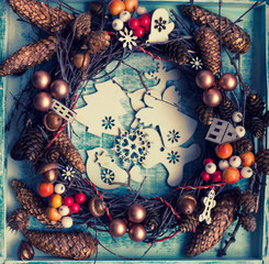 christmas wreath on the blue background/ handmade birch wreath with tree decorations