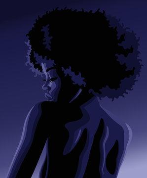 Profile portrait of beautiful young black woman in chiaroscuro lighting
