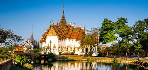 Amazing view of beautiful Dusit Maha Prasat Palace (The Grand Palace) with reflection in the water. Location: Ancient City Park, Muang Boran, Samut Prakan province,  Bangkok, Thailand. Panorama