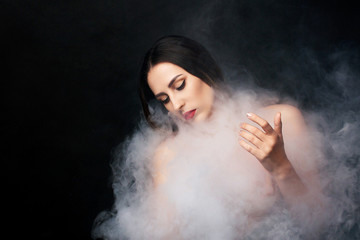 Attractive young girl and white smoke.