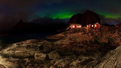 Panorama of romantic Fishing village in Norway - under Northern Lights